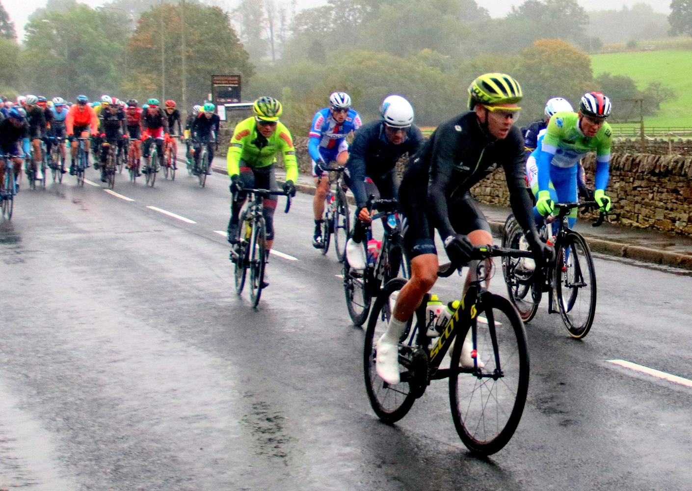 Cyclists on the UCI as is passes through addingham